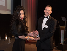 Grace Bian presents the highly commended award in the Transforming Society category to tve trustee James Fulcher who accepted it on behalf of Youth Career Initiative